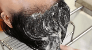 Scalp massage during shampooing.